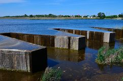 Dam. Reinforced concrete dam on the river Royalty Free Stock Images