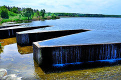 Dam. Reinforced concrete dam on the river Stock Photos