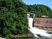 Dam Releasing Water. This is a dam in a small town here in Wisconsin releasing water one early spring day Royalty Free Stock Image