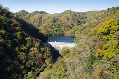 Dam on a reservoir in the mountains stock photo