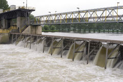Dam in a river. A dam  to regulate the water level for shipping and power generation Stock Images