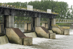 Dam in a river. A dam  to regulate the water level for shipping and power generation Stock Photography