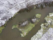 Dam on the river Klyazma. Grass and snow. Aerial view Stock Photo