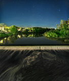 The dam on the river in Pskov. Built in 1974, the figures on the left of the concrete part Royalty Free Stock Images
