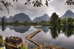 Dam on river Yulong, amid karst hills, Guilin, Guangxi, China. Stock Photos