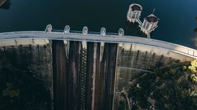 Dam of the Sau Reservoir in the Province of Girona, Catalonia, Spain. Amazing aerial view in a sunny day royalty free stock photo