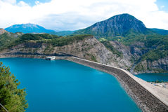 Dam of Serre-Ponçon, southeast France. Dam of Serre-Poncon, southeast France.. 123 m high earth core dam Stock Image
