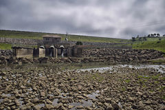 Dam sleeping. Water dam maintenance, normal operation of the turbine causes the water level is higher and the entire image is under water Royalty Free Stock Photos