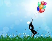 Dam som spelar med ballonger royaltyfria foton