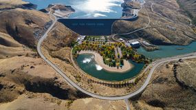 Lucky Peak Dam aerial view with fall colors. Dam in southern Idaho with a park that has a fountain and fall trees Royalty Free Stock Image