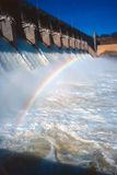 Dam spillway with rainbow. Shot of flowing spillway of dam with rainbow stock image