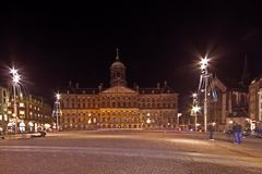 Dam Square in Amsterdam the Nethe. Rlands at twilight Royalty Free Stock Images
