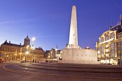 Dam Square in Amsterdam the Nethe. Rlands at twilight Stock Photo