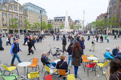 Dam Square in Amsterdam. Amsterdam, The Netherlands May 30 2013: Many tourists and locals gather in Dam Square in Amsterdam city royalty free stock photo