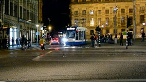 Dam square, Amsterdam, Netherlands, night traffic,. AMSTERDAM - SEP 12: night traffic on Dam square on September 12, 2013 in Amsterdam, Netherlands. Dam Square stock footage