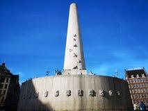 Dam Square i Amsterdam Netherlansen royaltyfria bilder