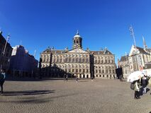 Dam square with the royal palace by day