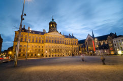 Dam Square with a view of the Royal Palace and the Nieuwe Kerk i Stock Photos