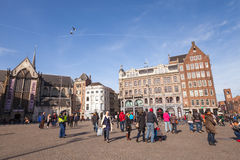 Dam Square view with walking tourists and ordinary people Stock Photo