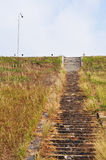 Dam stairs. On the brown field Royalty Free Stock Images