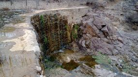 Dam. A stone dam, old, small, full of vicissitudes of life Royalty Free Stock Image