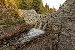 Dam on a stream Royalty Free Stock Photography