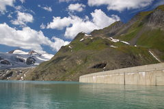 Dam in Swiss mountains Royalty Free Stock Image