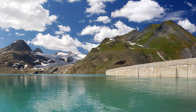 Dam in Swiss mountains Royalty Free Stock Images