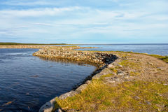 Dam to the island Muksalma, Solovetsky archipelago, Russia Stock Images