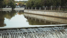 Dam on the urban river. The dam on the river in city Moscow stock video footage