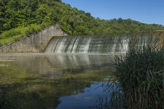 Dam Versailles Lake. Water trickling over a dam Stock Image