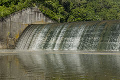 Dam Versailles Lake. Water trickling over a dam Stock Photography