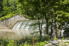 Dam Versailles Lake. Water trickling over a dam Royalty Free Stock Image
