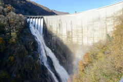 The dam of Verzasca on the italian part of Swtzerland. With open the floodgates Stock Image