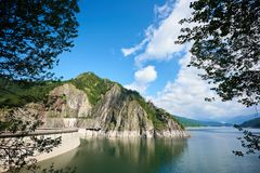 Dam Vidraru Lake in Romania. On a warm sunny beautiful day copyspace travel travelling tourism ecology environment nature calamity peace recreation geography stock photography