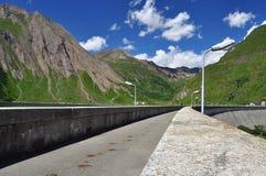 Dam walkway. Alpine lake (lago) Morasco, Formazza valley, Italy Royalty Free Stock Images