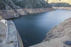 Dam Wall and Dam with Low Water Level. A dam and dam wall in South Africa with low water levels due to drought Stock Photography
