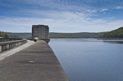 Dam Wall and Lake. Dam wall curving away to reveal the blue lake beyond Stock Images