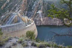Dam Wall and Dam with Low Water Level. A dam and dam wall in South Africa with low water levels due to drought Royalty Free Stock Photos