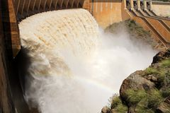 Dam wall with open sluice gates Royalty Free Stock Image