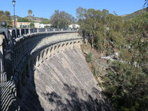 Dam wall at reservoir Stock Images