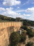 Dam wall. Set against greenery in South Stock Photography