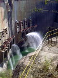Dam wall with shooting waters Royalty Free Stock Image