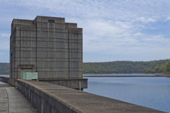 Dam Wall Watch Tower. Watch tower in the middle of the dam wall. Lake and trees in background Stock Photo