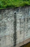 Dam wall. With water from pipe Stock Photo