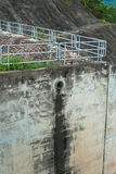 Dam wall. With water from pipe Royalty Free Stock Images