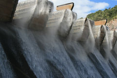 Dam Wall Windy. Dam wall with wind blowing the water causing a spray Stock Photo