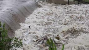 Dam water during heavy rains stock footage