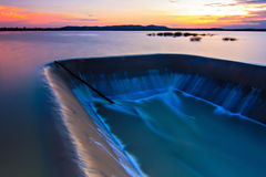 Dam water smooth. Sunset at yasothon thailand royalty free stock photography