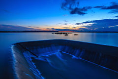 Dam water snnset. Dam water sunset at yasothon thailand royalty free stock images
